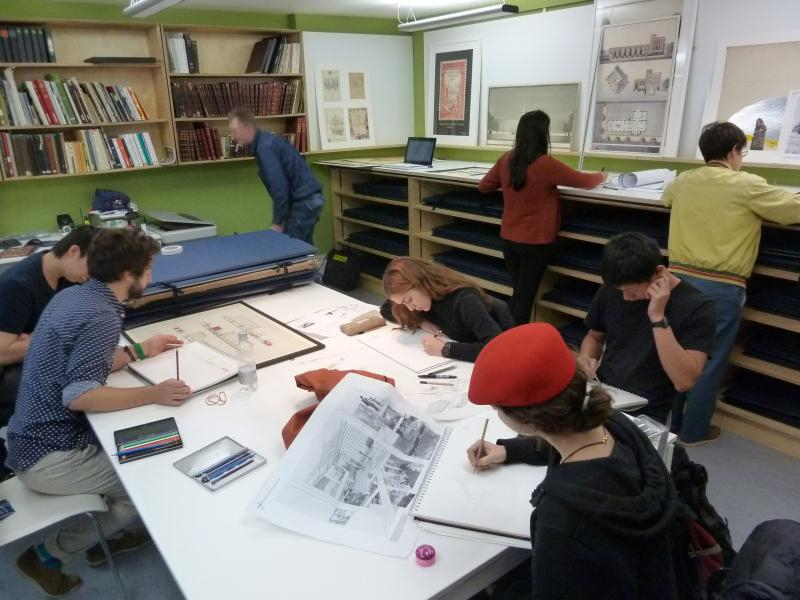 Students studying selected portfolios of AA Honours graduates.