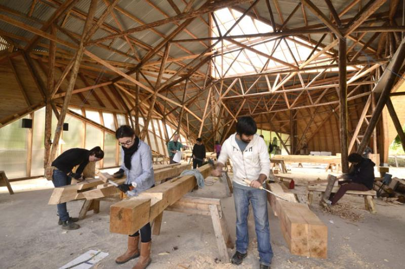 New student accomodation building under construction in Big Shed - Abdullah Omar and Bojana Grebenar preparing mortise and tenon joints.
