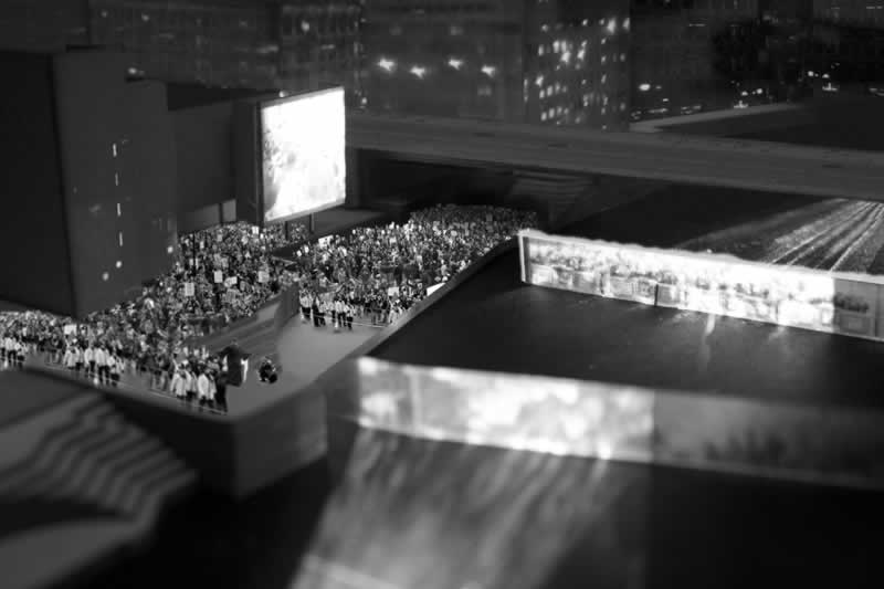 The Virtual Square uses images projected onto waterscreens on the Thames to use the un-inhabitable river space (midground) as an active agent linking the city surrounding (backdrop) to the activity and experience on the banks (foreground).