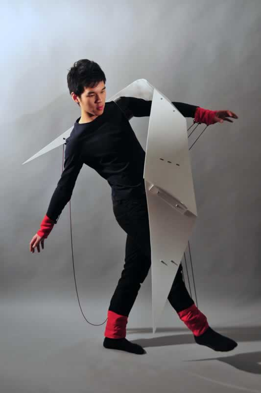 A garment made of white Perspex, which restricts the body movement.