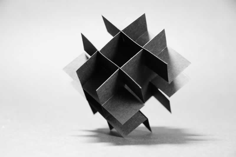 A paper model studying the negative space of a Rubik's Cube.
